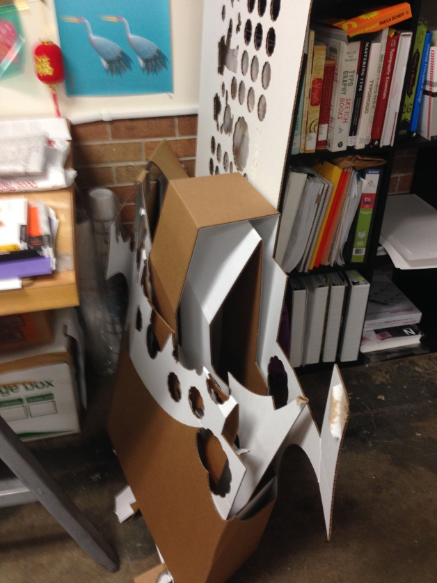 the remaining piece of cardboard showing the cutouts