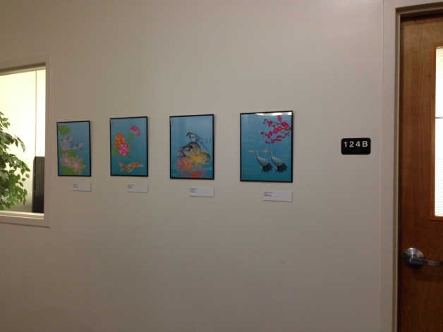 the illustrations are in front of study room at the UT Arlington library