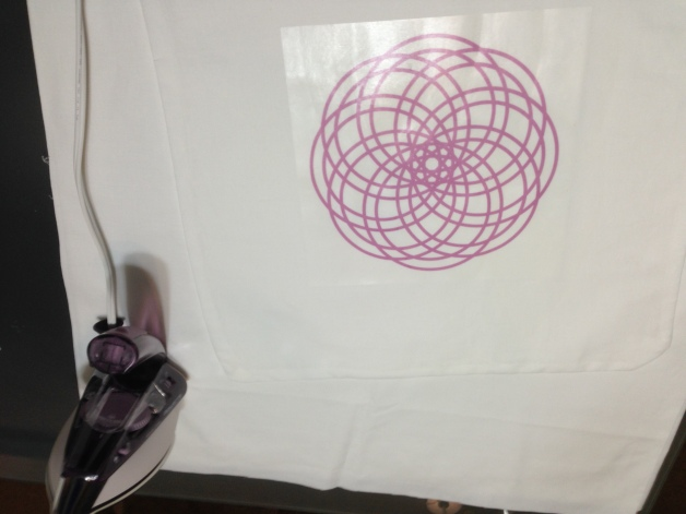 process of ironing on a mooncake design to a pillowcase